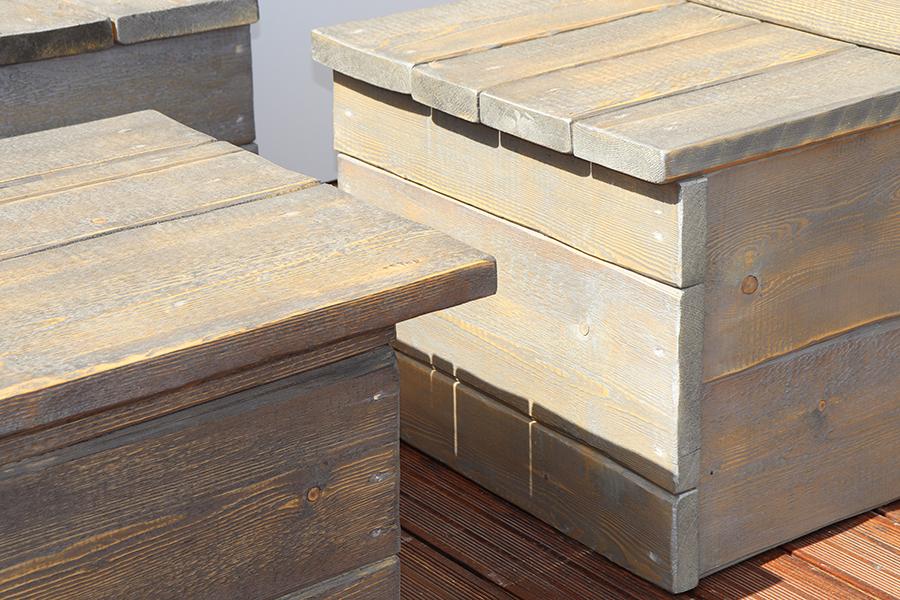 dettaglio tavolo grigio con pache da esterno realizzato da linea legno